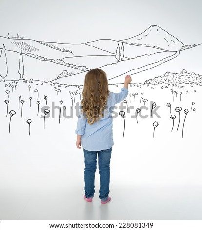 little child draws nice and detailed nature sketches - stock photo