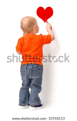 Little child draws red heart - stock photo