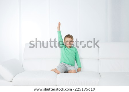 little child extends his arm happily