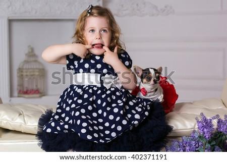 Little child girl is doing grimace  - stock photo