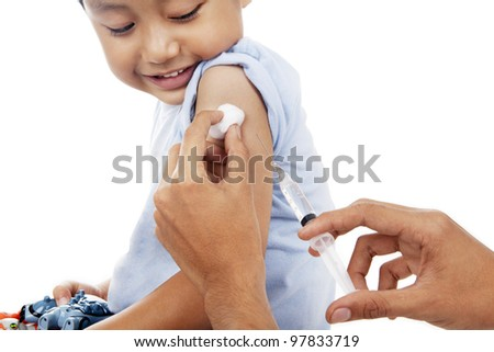 Little child have a vaccination shot in studio isolated on white - stock photo