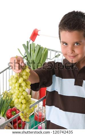 Little child holding grape - stock photo