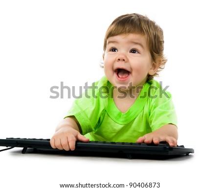 Little child holding keyboard over white background - stock photo