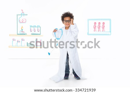 little child imagine his future, standing in front of a drawing wall - stock photo