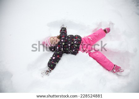 Little child in a clear white snow - stock photo
