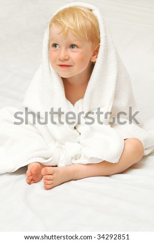 Little child in white towel