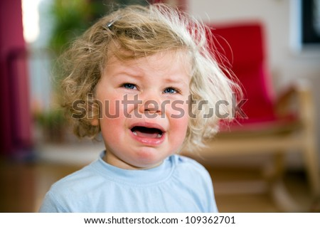 little child is crying - stock photo