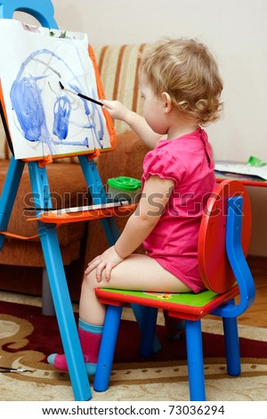 little child is painting - stock photo