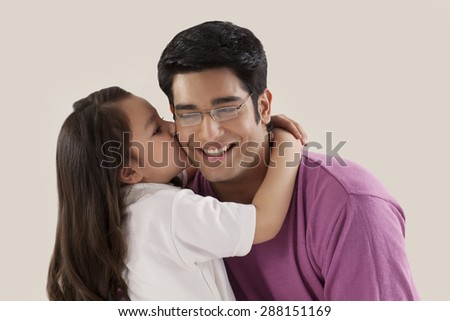 Little child kissing her father - stock photo