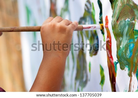 Little Child Painting With  Brush - stock photo