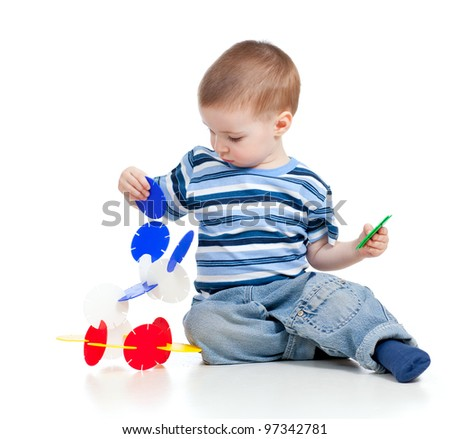 little child playing with color toy over white background