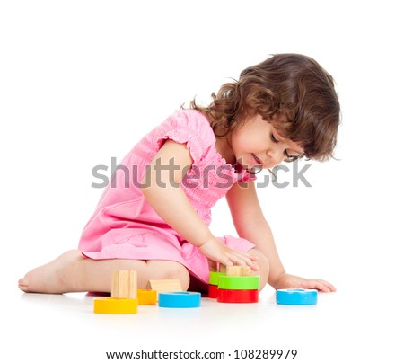 little child playing with colorful toys, isolated over white - stock photo