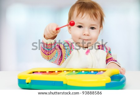 little child playing with with toys - stock photo