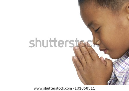 Little Child praying over white background. - stock photo