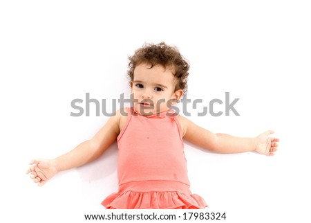 Little Child Resting on white floor .