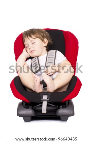 Little child sleeping in a vehicle car safety seat. Isolated on white. - stock photo