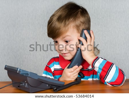 Little child talking to an telephone