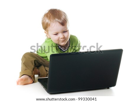 Little child using a laptop