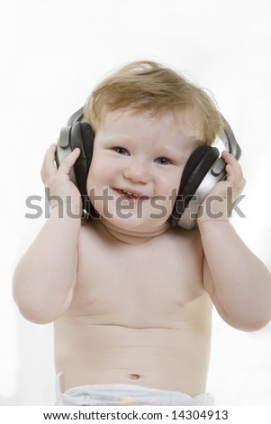 little child with a headphones - stock photo