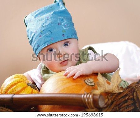 Little child with a pumpkin