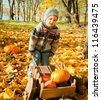 little child with a wheelbarrow full of pumpkin - stock photo