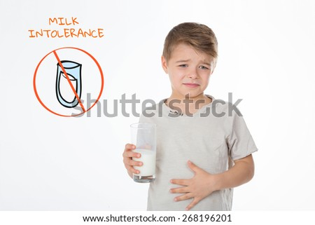 little child with billyache standing near a graphic symbol of eating disorders - stock photo