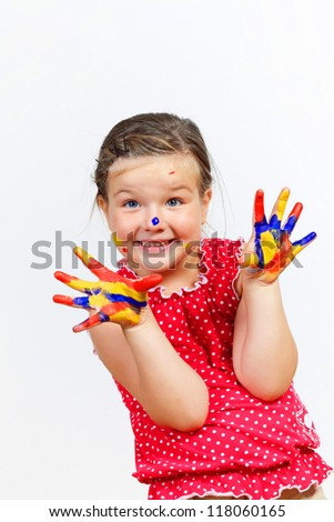 little child with hands painted in colorful paints ready for hand prints - stock photo