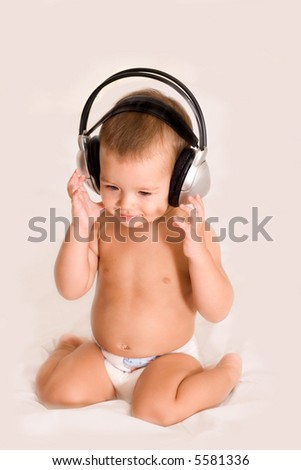 Little child with headphones - stock photo