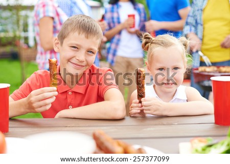 Little children at barbecue with family - stock photo