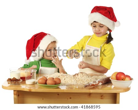 Little children cooking the Christmas cake - stock photo