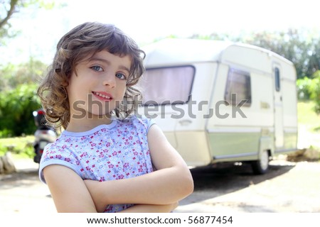 little children girl posing caravan camping vacations summer - stock photo
