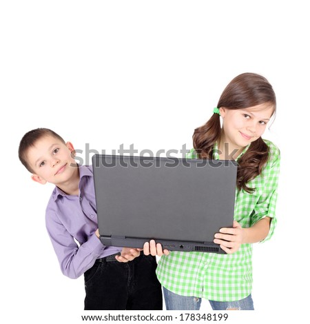 little children looking out of the notebook - stock photo