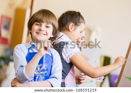 Little children painting and playing at kindergarten - stock photo