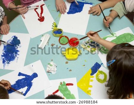 little children painting during art class - stock photo