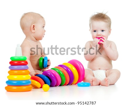 little children playing with color toys - stock photo