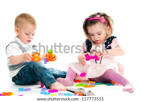little children playing with toys - stock photo