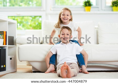 Little children together at home - stock photo