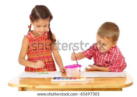 Little children with watercolor paintings, isolated on white