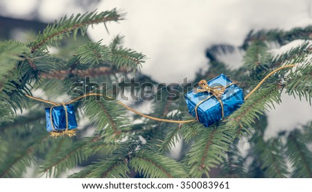 Little christmas gifts on Christmas tree - stock photo