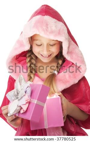Little Christmas girl open her present - stock photo