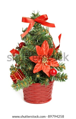 Little christmas tree with decorations isolated on white background - stock photo