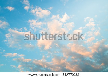 Little clouds on the blue sky. Natural background.