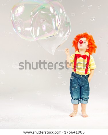 Little clown and bubble soap - stock photo