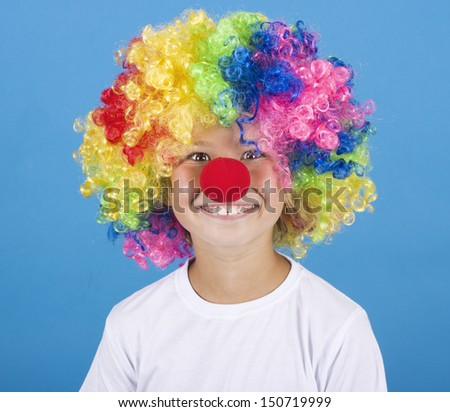 Little clown boy on blue background - stock photo
