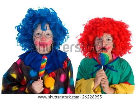 Little clowns with sweet lollipops - stock photo