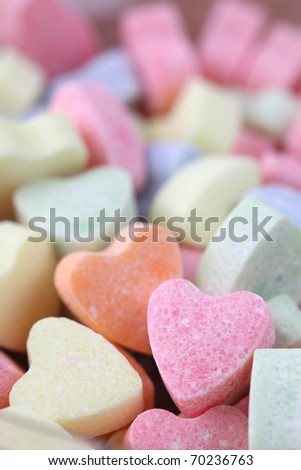 Little colorful candy hearts background. Shallow dof - stock photo