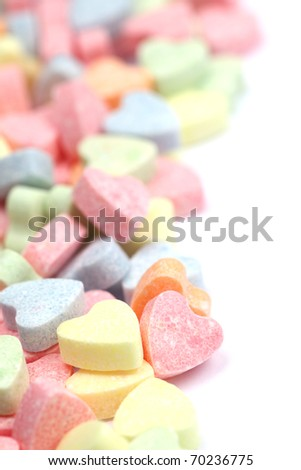 Little colorful candy hearts isolated on white background. Shallow dof - stock photo
