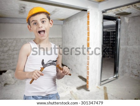 Little construction worker on a construction site background. Image with shallow depth of field.