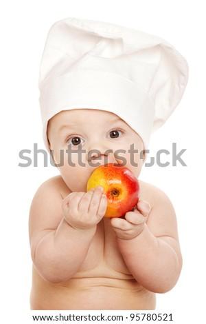 little cook eats an apple - stock photo