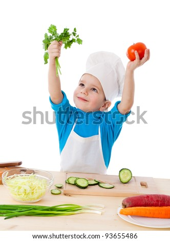 Little cook raising up hands with parsley and tomatoes, isolated on white - stock photo